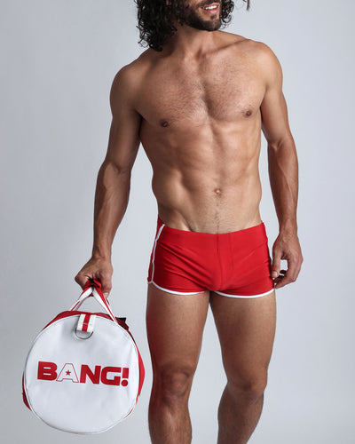 Cherry Swim Shorts Bang Clothes Men Swimwear Swimsuits front view with gym duffel travel bag