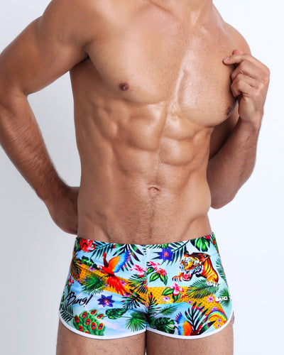 These men's swim shorts features fun and enegetic jungle graphics in bold colors, with a tiger illustration.