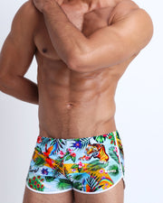 This swimsuit for men features fun and colorful jungle-style graphics in bold colors with a prominent BANG! Illustration.