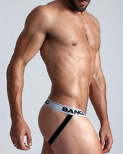 Right side view of a hot male model wearing men's jocks with low rise fit, by the Bang! Brand.