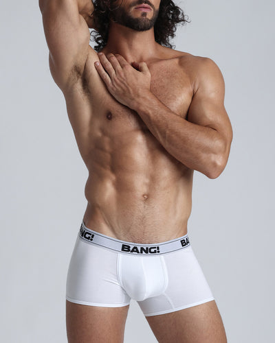 Frontal view of a sexy guy wearing a men's premium cotton boxer brief in white as made by the Bang! men's underwear brand.