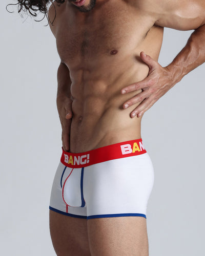 Left side view of a hot guy wearing a white and red cotton boxer brief for men by the Bang! menswear brand.