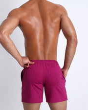 Backside view of men's gym jogger sweatshorts from Bang! Clothes brand with low-rise sit and shape-enhancing cuts.