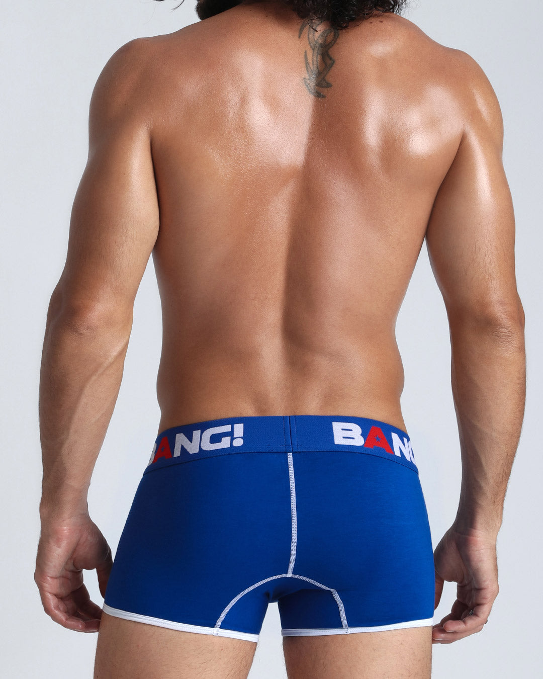 Frontal view of a fit man wearing men's premium cotton boxer brief in blue by the Bang! men's underwear brand from Miami. Frontal view of a fit man wearing men's premium cotton boxer brief in blue by the Bang! men's underwear brand from Miami.