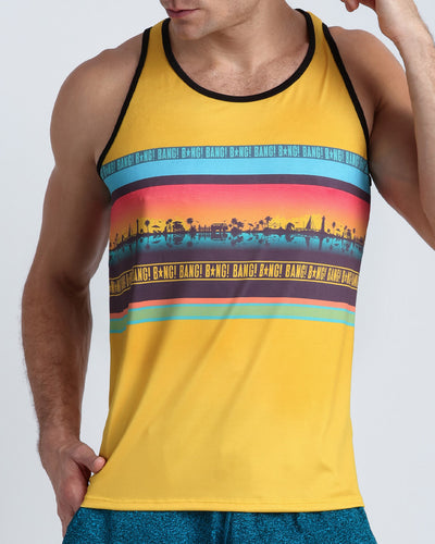 Frontal view of a sexy male model wearing men's tank top by the Bang! Clothes brand of men's beachwear from Miami.