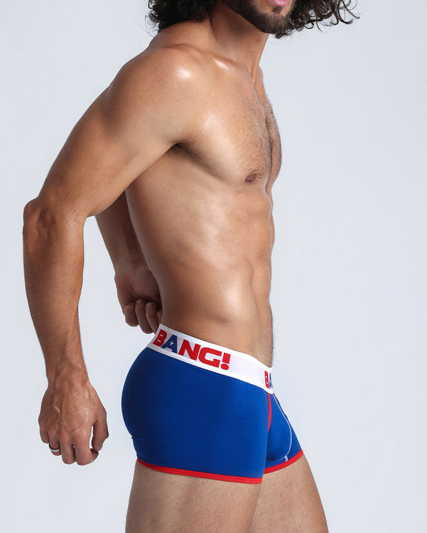 Right side view of a male model wearing blue boxer brief made of cotton, with low-rise fit for style and performance.