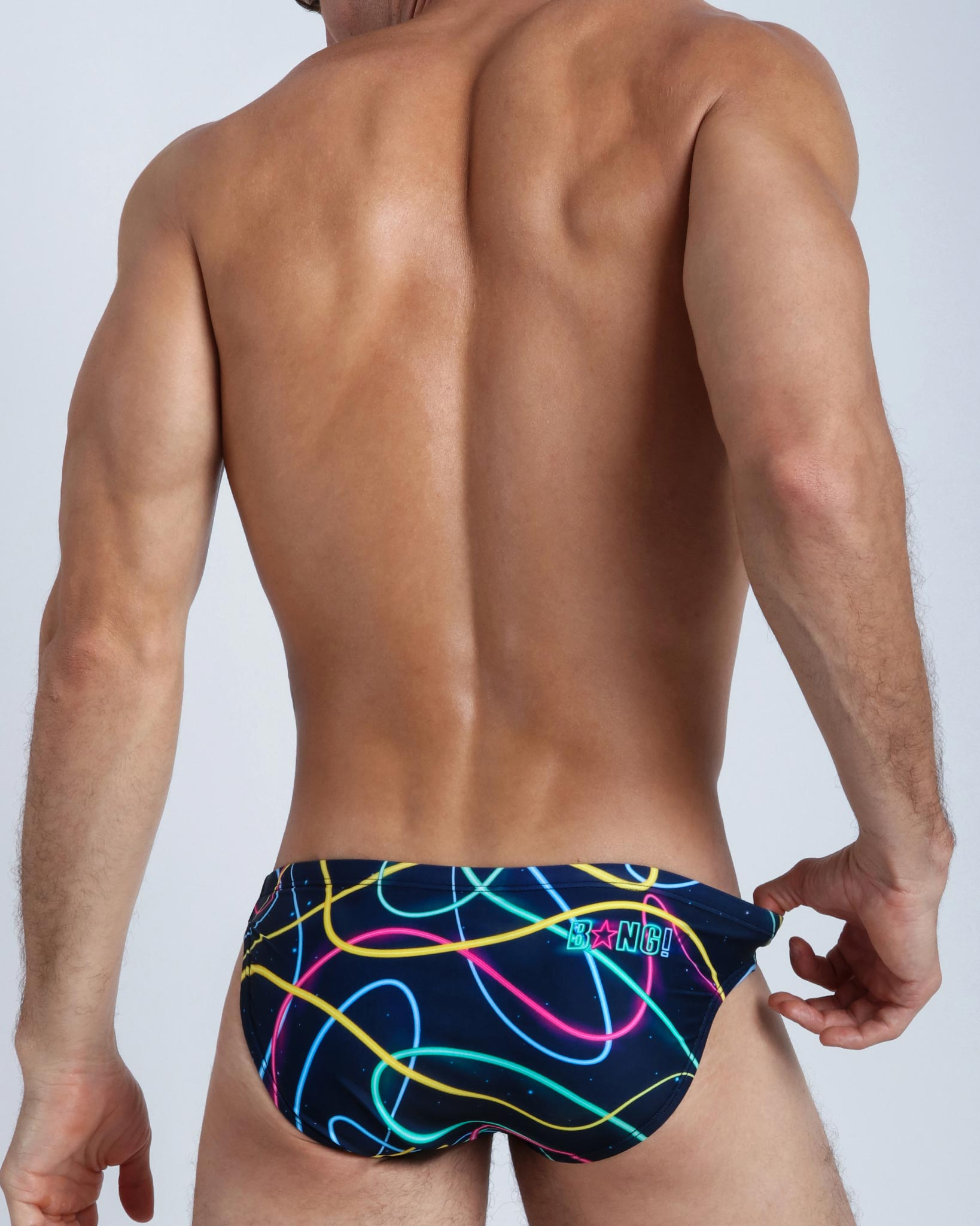 Frontal view of a sexy male model wearing men's swimsuit by the Bang! Clothes brand of men's beachwear from Miami.