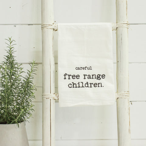 """careful free range children"" tea towel"