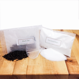 Kombucha making kit has all the supplies you need for brewing, including loose-leaf black tea, sugar, and a funnel