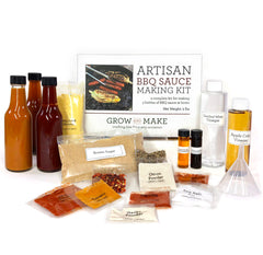 Artisan BBQ Sauce Main photo picturing the box, spices, 3 bottles of homemade sauce, a funnel, and vinegar.
