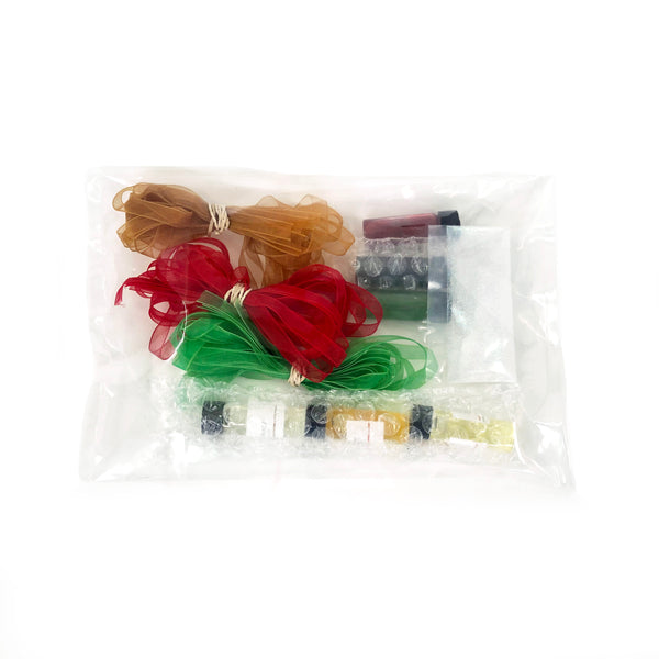 Holiday crafting supply kit: ribbons, glitter, candle dye, soap dye, fragrance oil, candle scent, soap fragrance