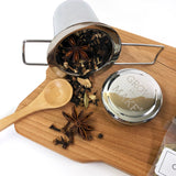 Chai Tea Making Kit with spices, loose leaf tea, tea tin, and stainless steel strainer