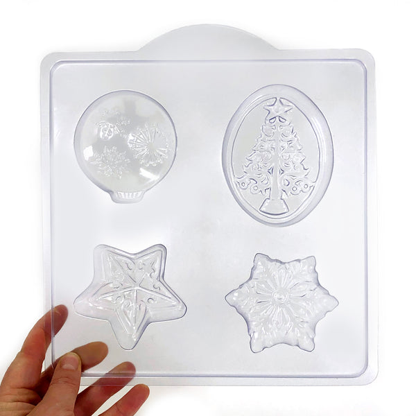 Holiday soap mold with festive tree, decoration, star, and snowflake