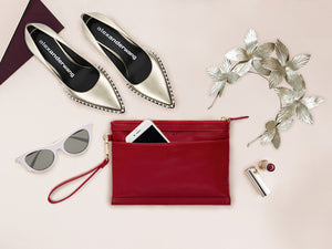 red leather clutch bag with inbuilt phone charger