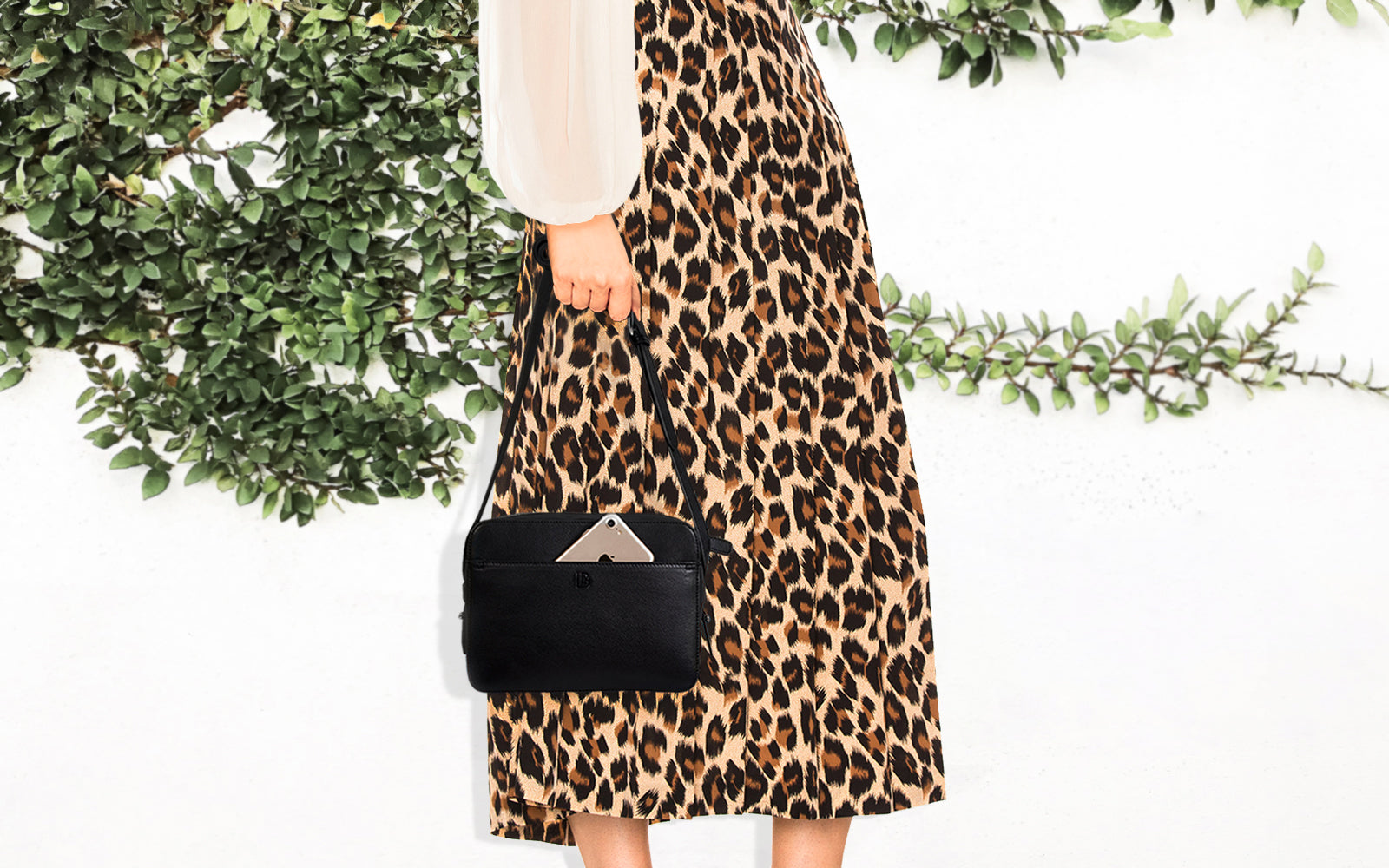 spring racing black leather bag with phone charger animal print midi skirt