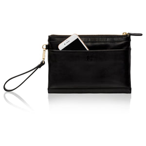 Back view of black leather wristlet clutch bag showing phone pocket for charging iPhone or Android. Clutch style with detachable wristlet.