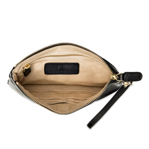 Inside view of black leather wristlet clutch bag showing tech pocket zipped closed and credit card pockets.