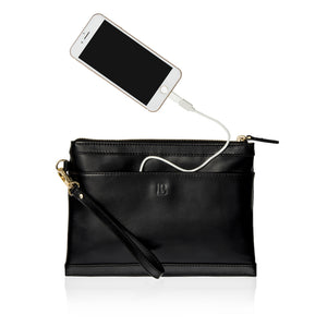 Back view of black leather wristlet clutch bag showing phone plugged into bag's charging cable.