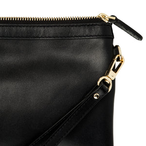 Close up of Lorna & Bel Olivia wristlet clutch bag in black leather showing light gold hardware.