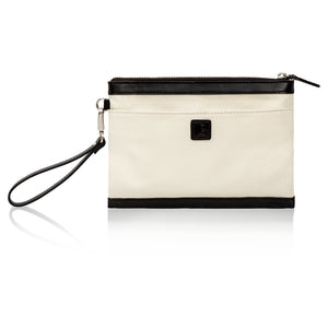 Back view of beige canvas and black leather wristlet bag with inbuilt phone charger.