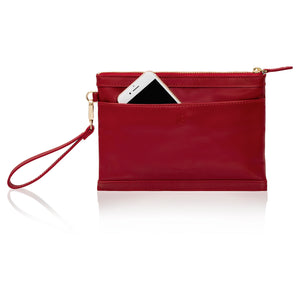 Back view of red leather wristlet bag with inbuilt phone charger showing phone pocket.