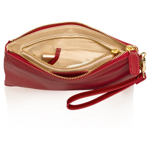 Interior view of red leather wristlet bag with inbuilt charger showing tech pocket unzipped.