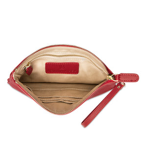 Interior view of red leather wristlet bag with inbuilt phone charger showing tech pocket zipped up and credit card pockets.