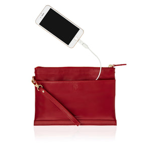 Back view of red leather wristlet with inbuilt phone charger showing phone plugged into the bag's phone charging cable.