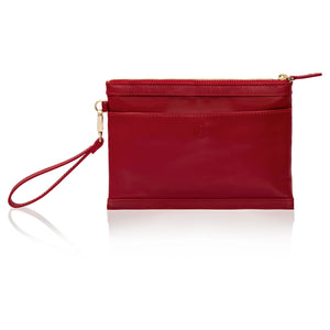Back view of red leather wristlet bag with inbuilt phone charger.