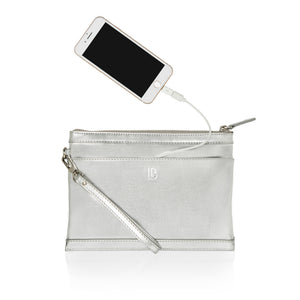 Silver leather wristlet bag with inbuilt phone charger showing charging cable and phone pocket.