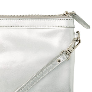 Close up of silver leather wristlet bag with inbuilt phone charger.