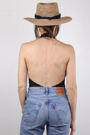 Backless lace bodysuit in Black.