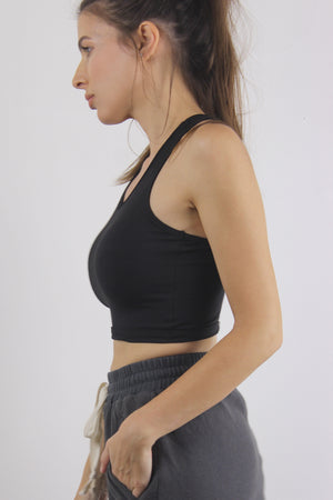 Black sports bra top, side.