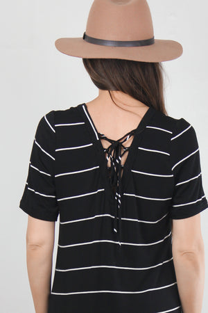 Black and white striped dress with lace up back. Image 5