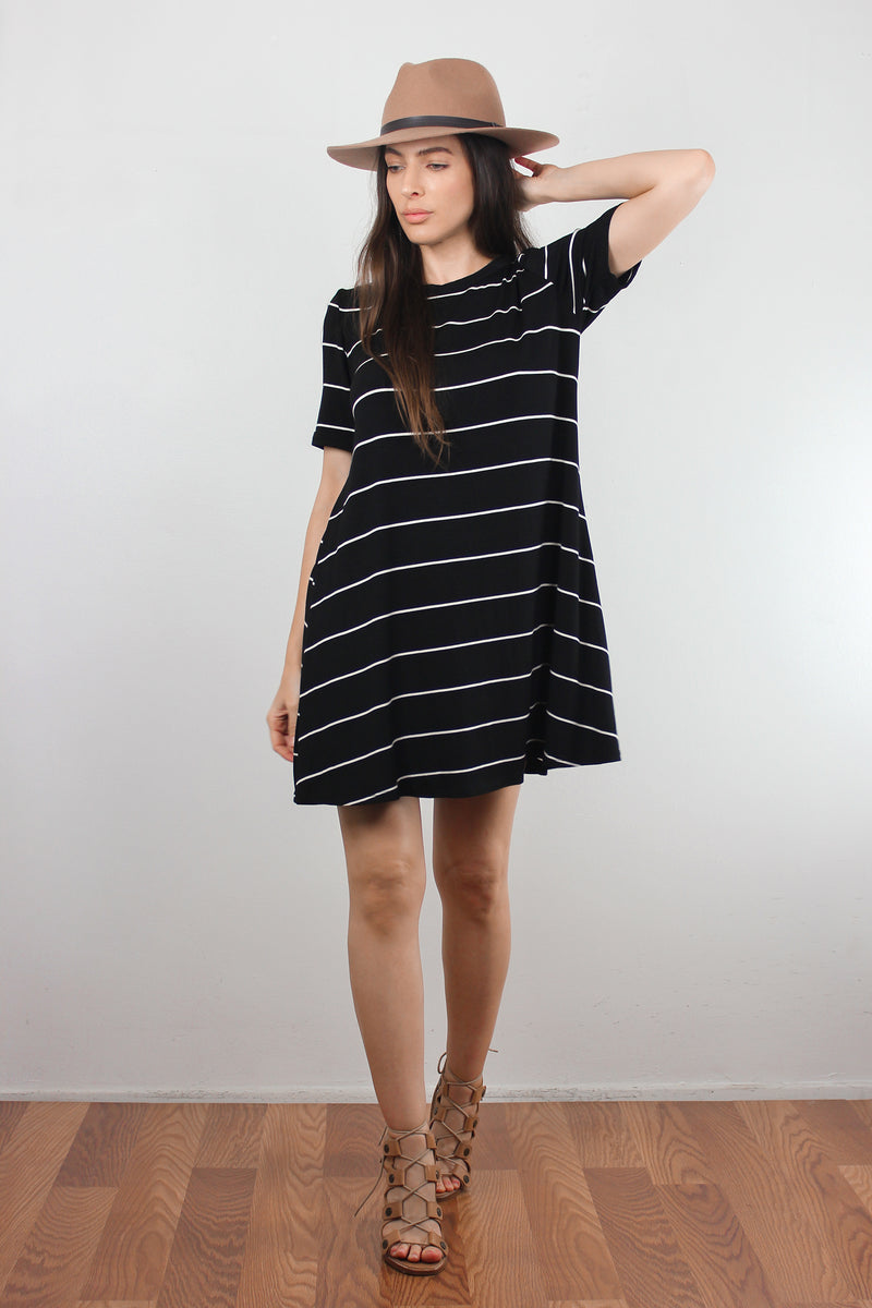 Black and white striped dress with lace up back. Image 2