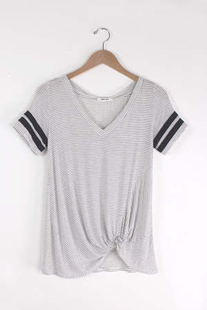 Black and white striped sporty tee shirt with knot front. 4