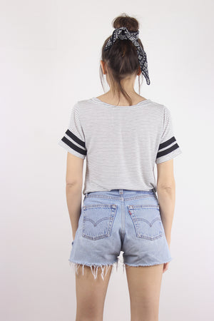 Black and white striped sporty tee shirt with knot front. 3