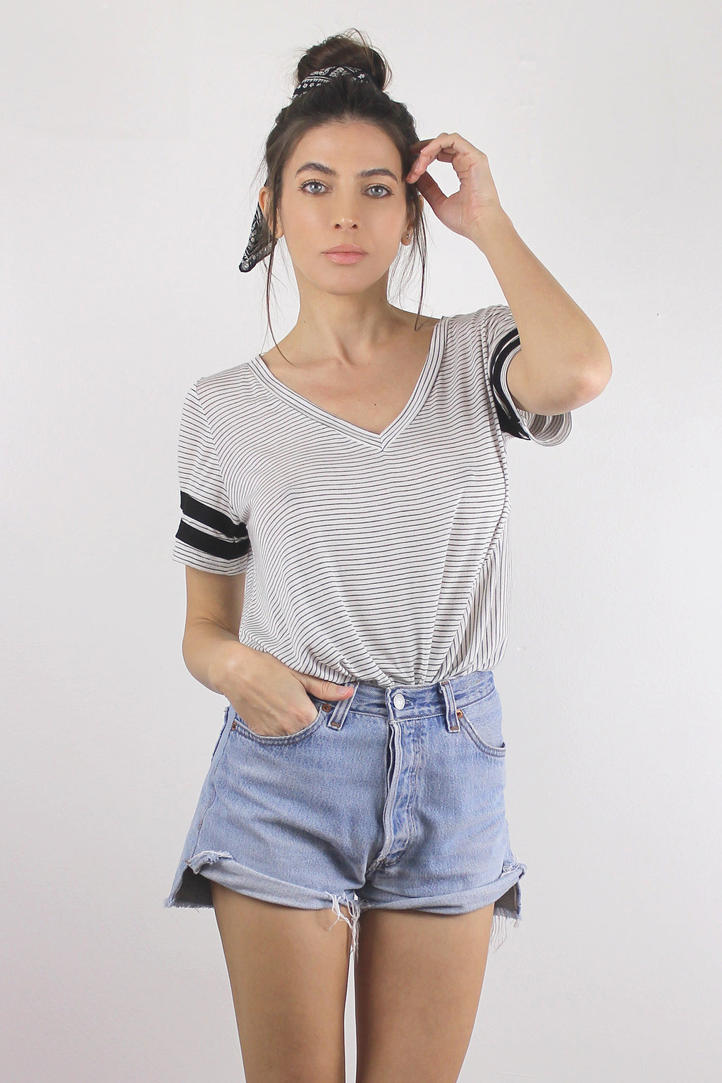 Black and white striped sporty tee shirt with knot front.