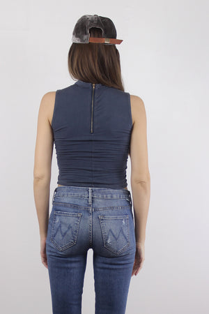 Blue cropped mock neck tank top with exposed back zipper. 3