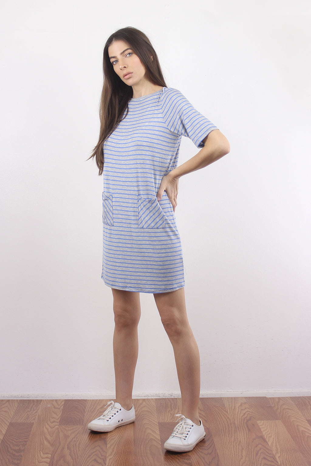 Light blue and grey striped tee shirt dress with front pockets.