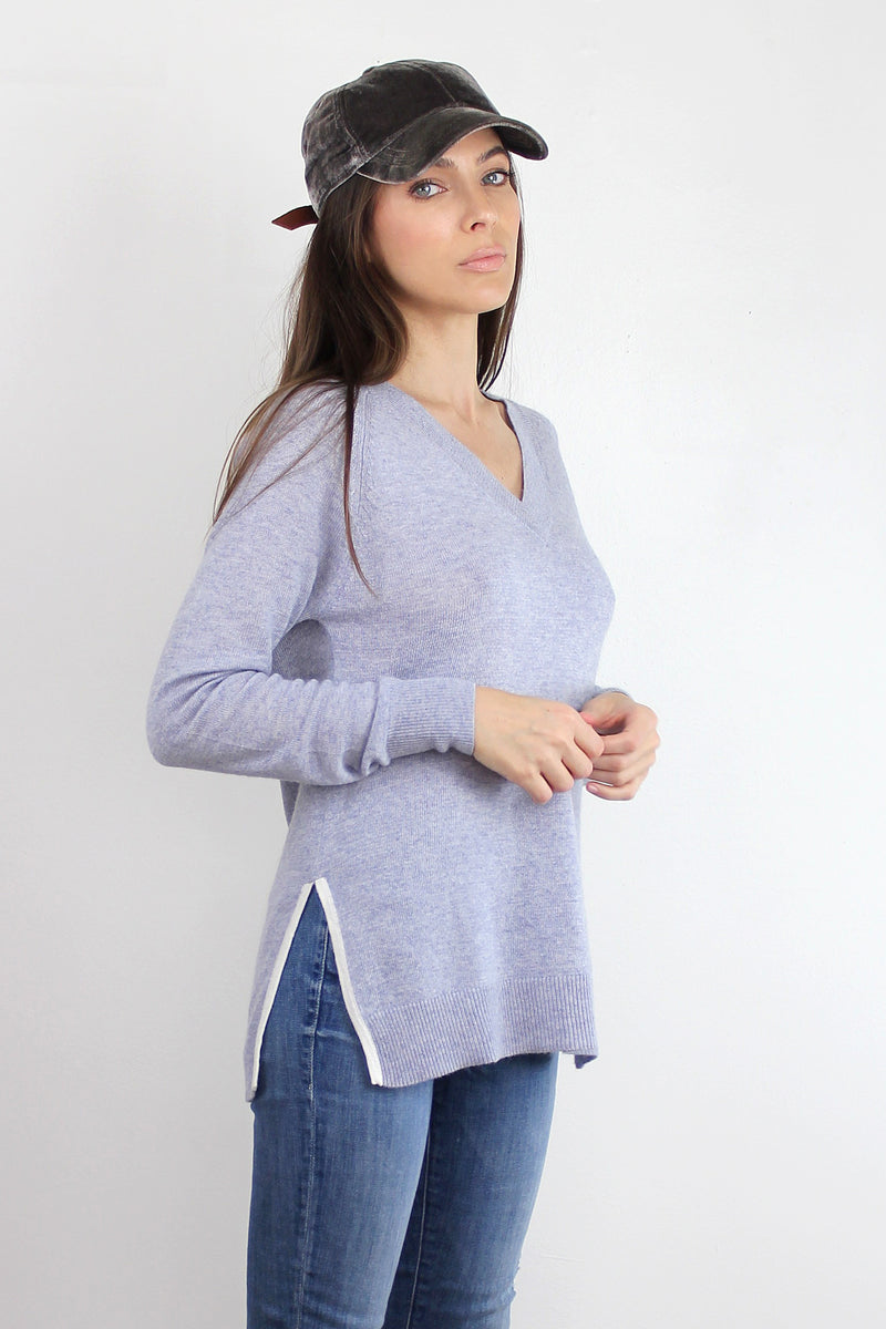 V-neck sweater with side slits, in heather Blue. Image 2