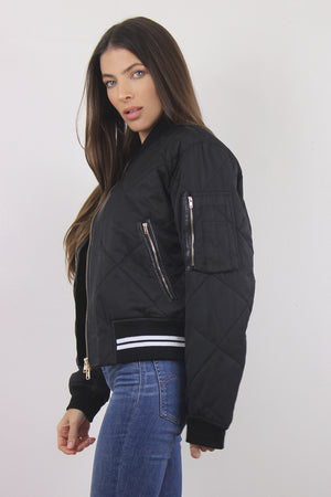 Black quilted varsity bomber jacket with arm pocket.