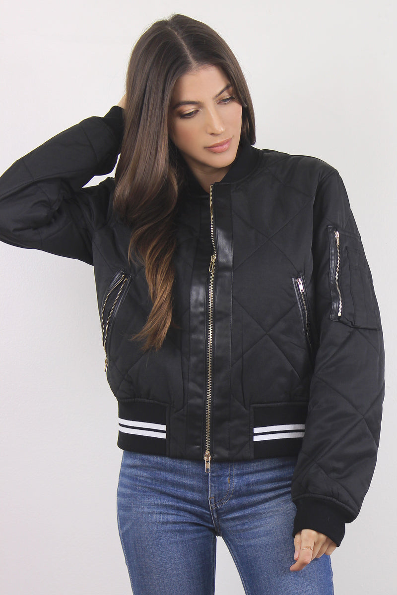 Black quilted varsity bomber jacket.