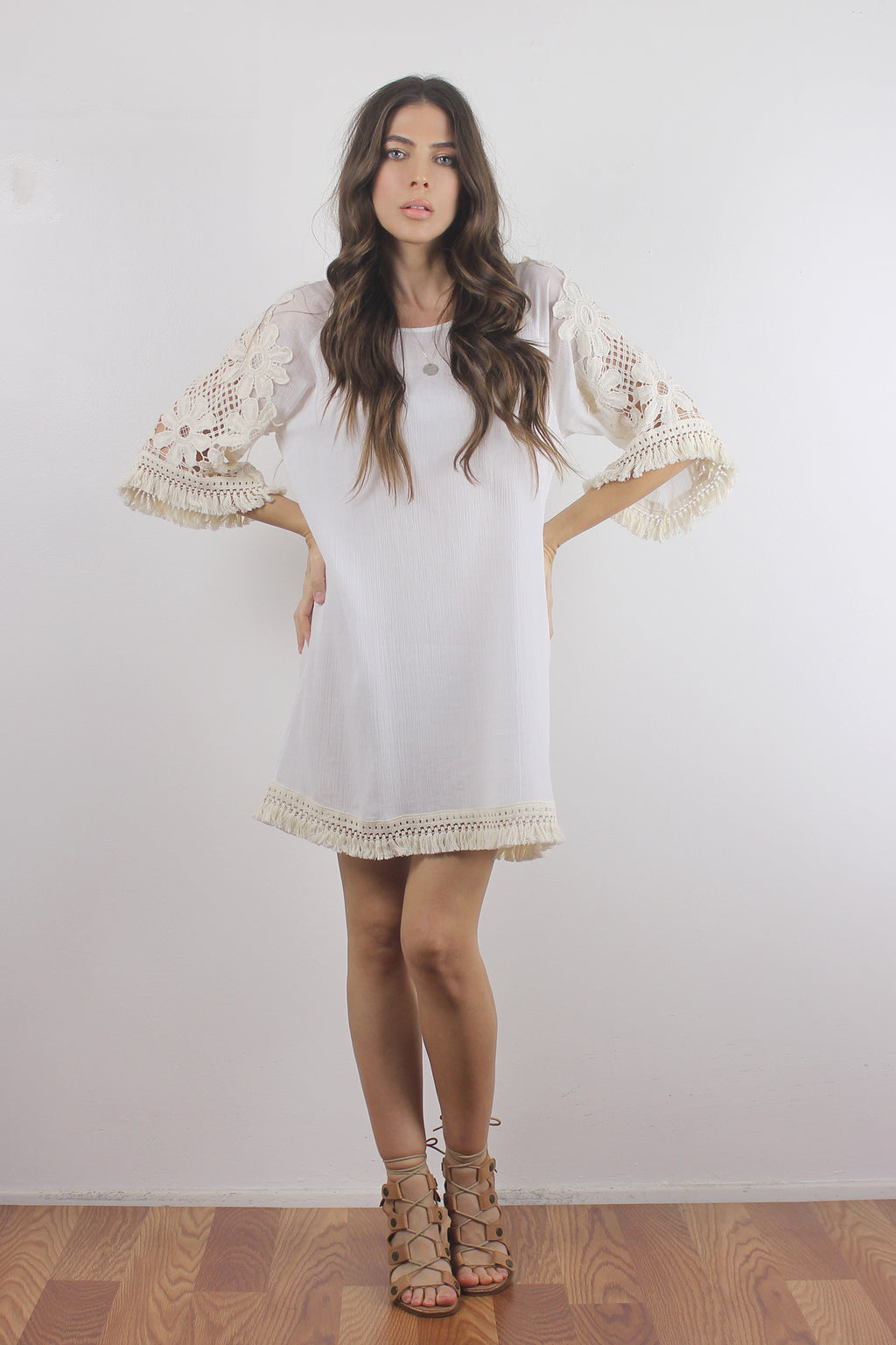 Crochet sleeve dress with fringe detail.