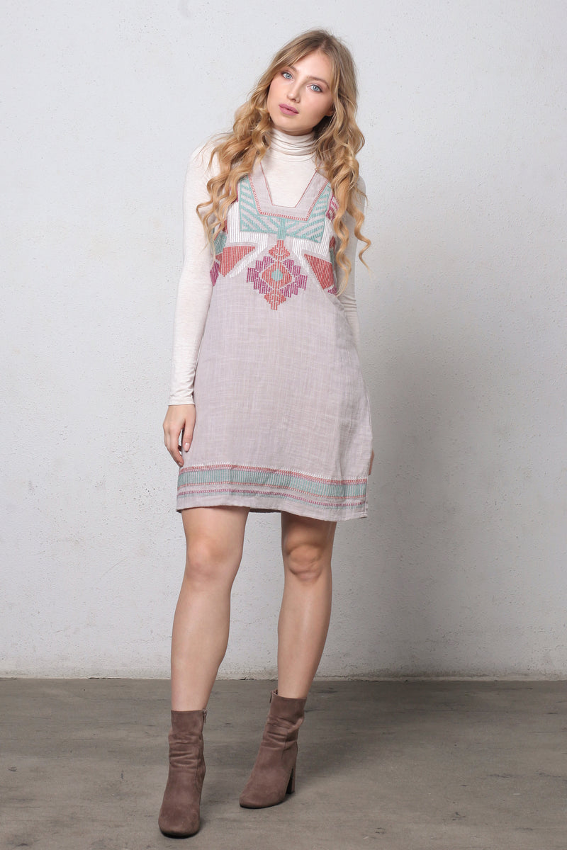 Embroidered jumper dress.