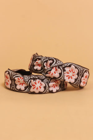 Floral embroidered knot top headband, in brown/pink.