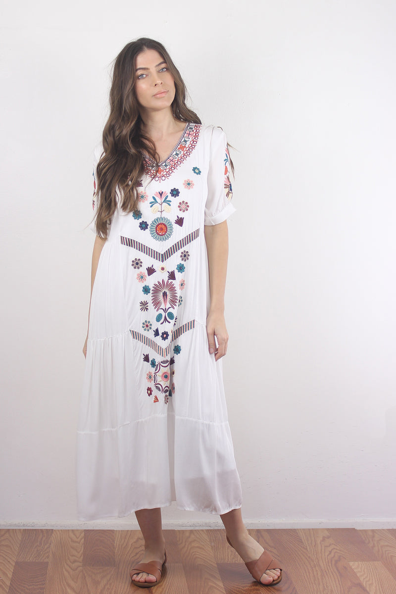 Embroidered mumu dress in white.