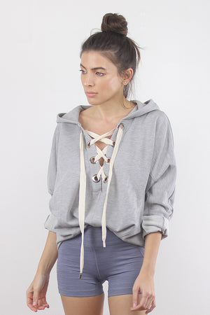 Lace up hooded sweatshirt in Grey. 1