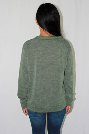 Knit top with lace up neckline in green. 3