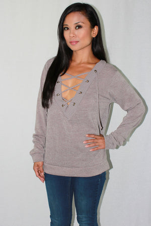 Taupe lace up knit top.